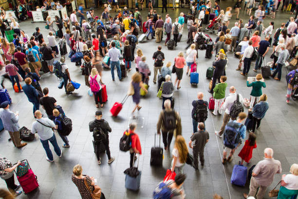 rush hour at king's cross train station - airport terminal stock photos and pictures