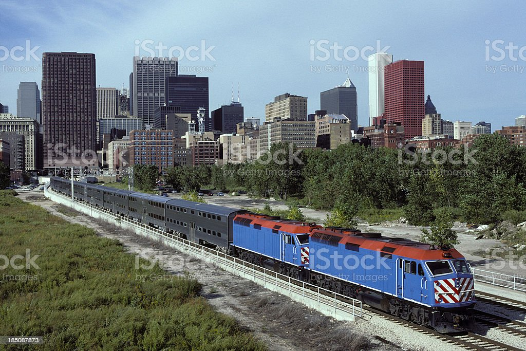 Rush hour double-decker commuter train departs city stock photo