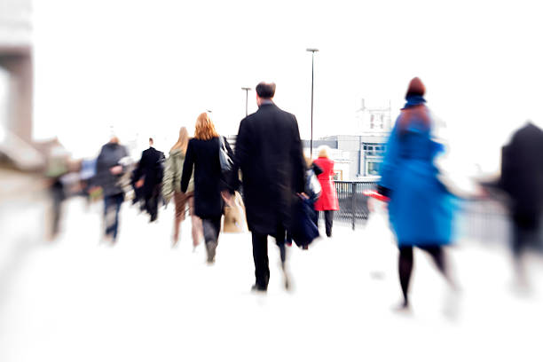 rush hour: office workers abstract blur - perpetual motion stock photos and pictures
