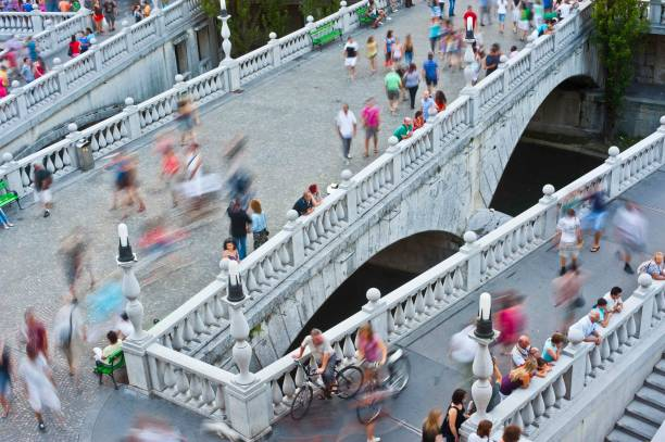 Rush hour on the bridges Three bridges in Ljubljana's city center on the rush hour  - it is walking zone only ljubljana stock pictures, royalty-free photos & images