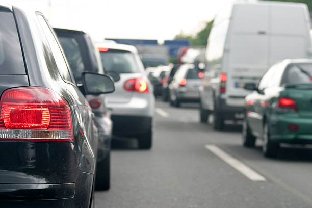 Rush hour on the highway Traffic jam on a german highway with focus on the left back light. north rhine westphalia stock pictures, royalty-free photos & images