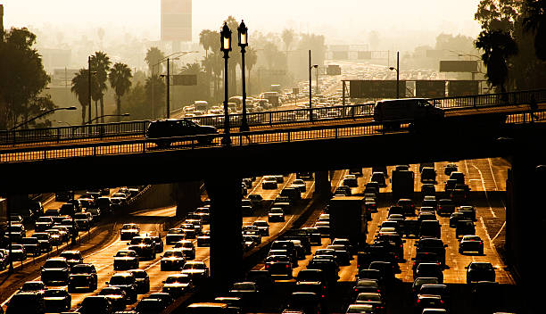 Rush Hour Rush hour in downtown Los Angeles, California on highway 110. smog stock pictures, royalty-free photos & images