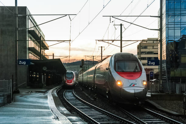Rush hour Zug, CHE - January 4, 2016: two Pendolino trains are stopping in Zug station. zug stock pictures, royalty-free photos & images