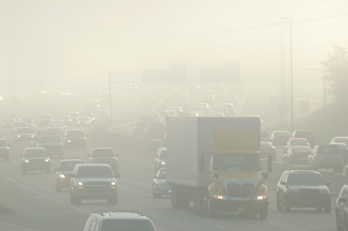 Rush hour traffic with smog.related: