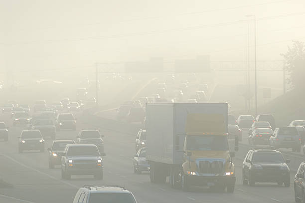 Rush Hour Smog Rush hour traffic with smog.related: smog stock pictures, royalty-free photos & images
