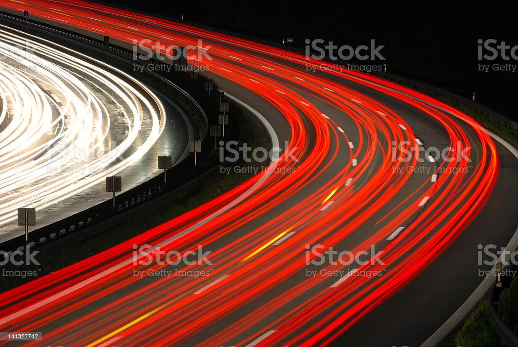 rush hour traffic at night on multiple lane highway royalty-free stock photo