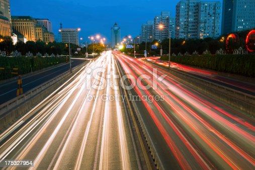 istock Rush hour traffic at night on multiple lane highway 175327954