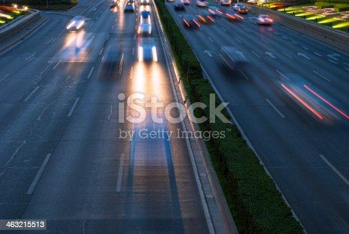 istock Rush hour traffic at night on multiple lane highway 463215513