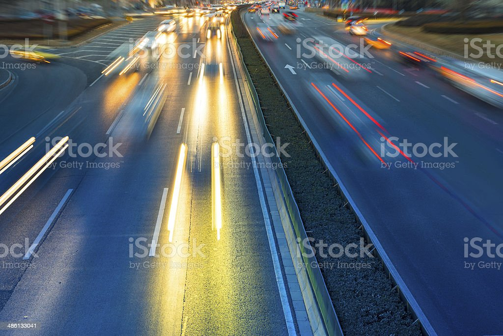 Rush hour traffic at night on multiple lane highway stock photo