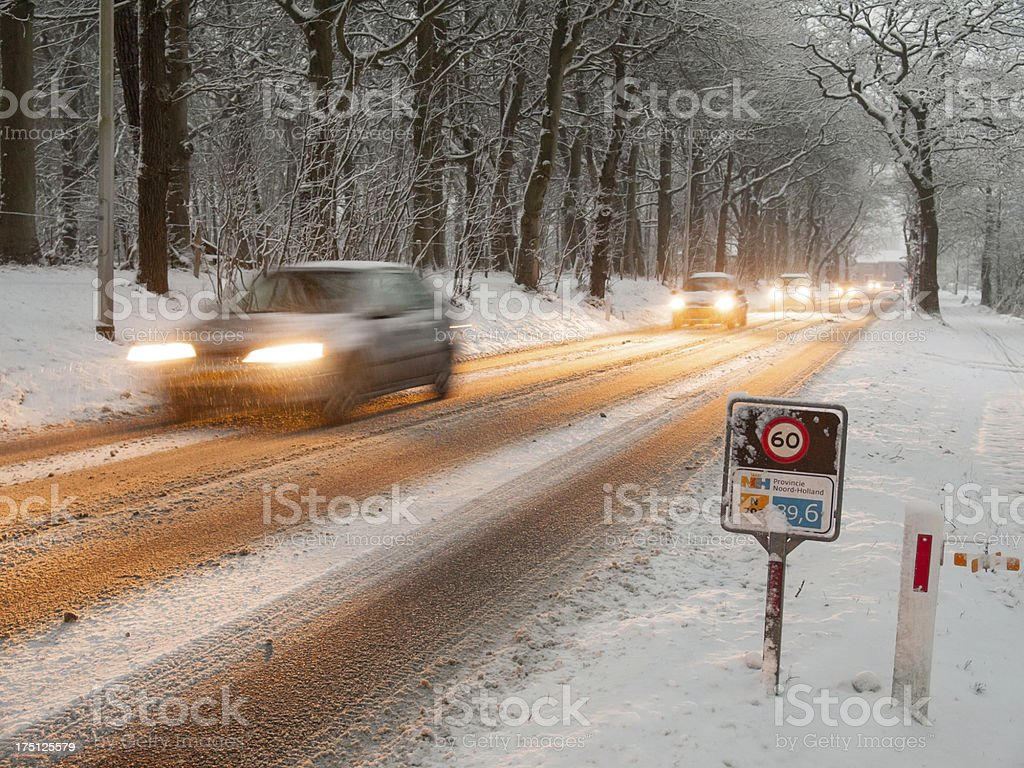 rush hour traffic in a snow storm stock photo