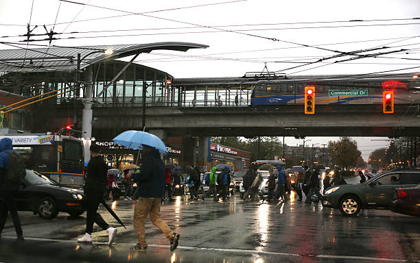 Rush Hour Traffic in the Rain, Commercial-Broadway Station, Vancouver, Canada stock photo