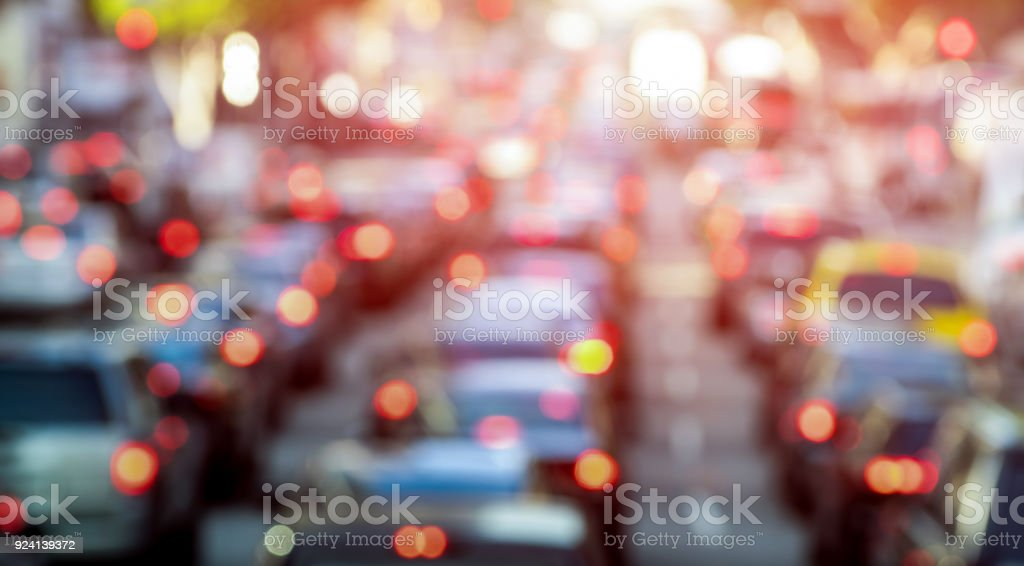 Rush hour with defocused cars and generic vehicles - Traffic jam in Los Angeles downtown - Blurred bokeh postcard of american iconic city with dark contrast sunshine filter - Transportation concept stock photo