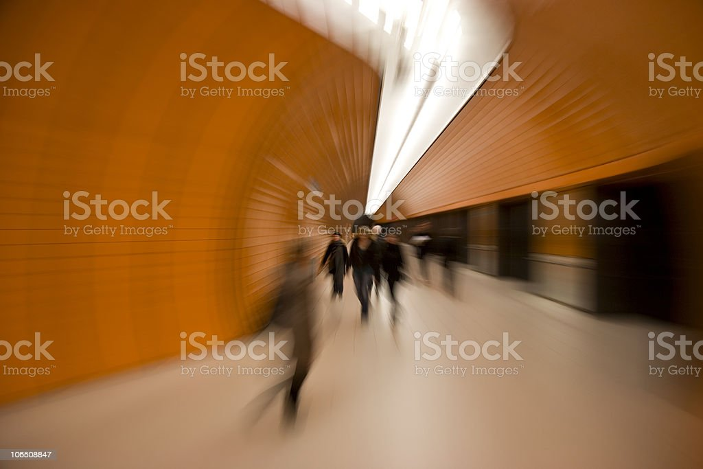 rush speed - fast commuters in modern orange tunnel royalty-free stock photo