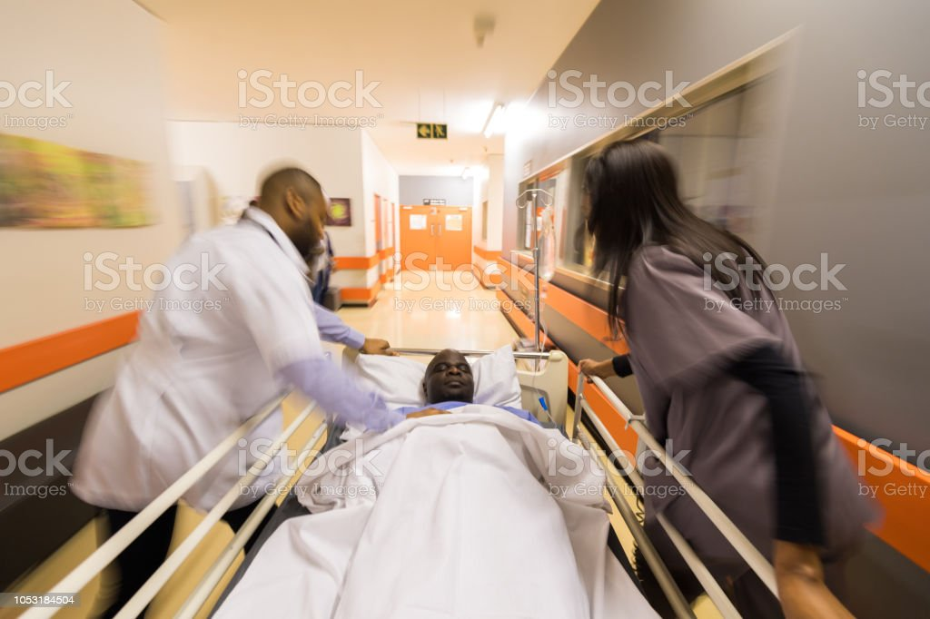 Doctors rushing a patient to the emergency ward