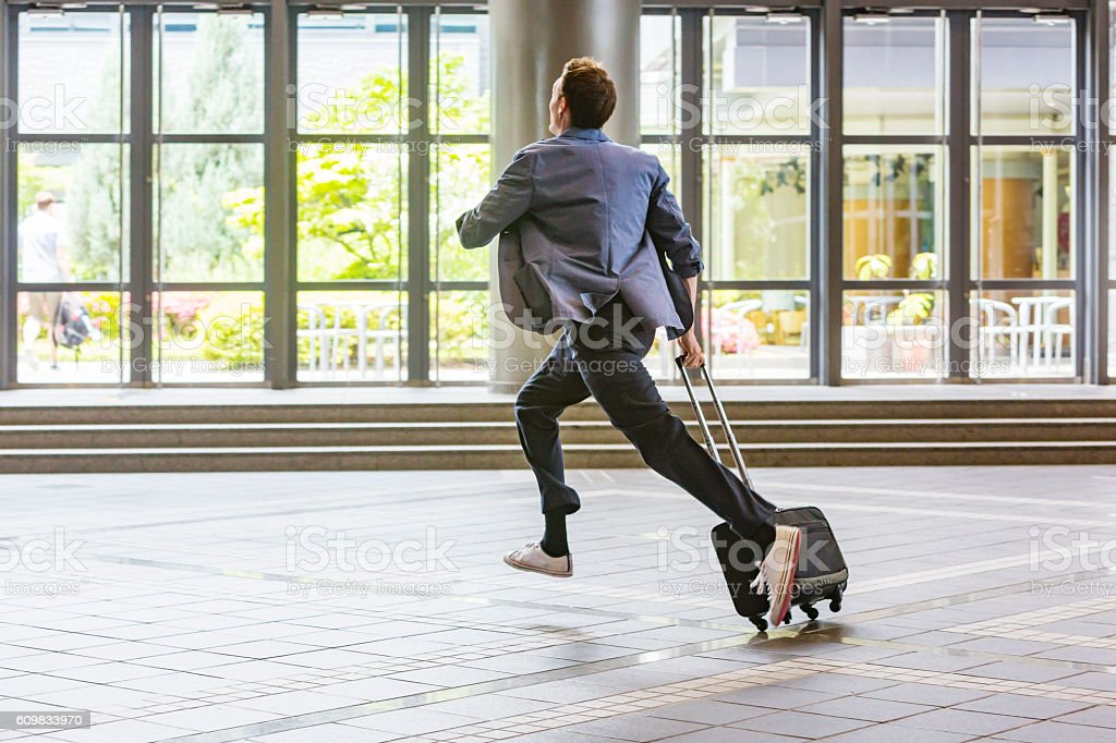 Rushing Business Person Running With a Suitcase stock photo