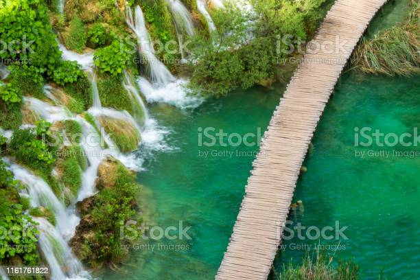 Photo of Rushing pure fresh water cascades down the natural barriers into the azure colored Lake Kaluđerovac at the Plitvice Lakes National Park in Croatia
