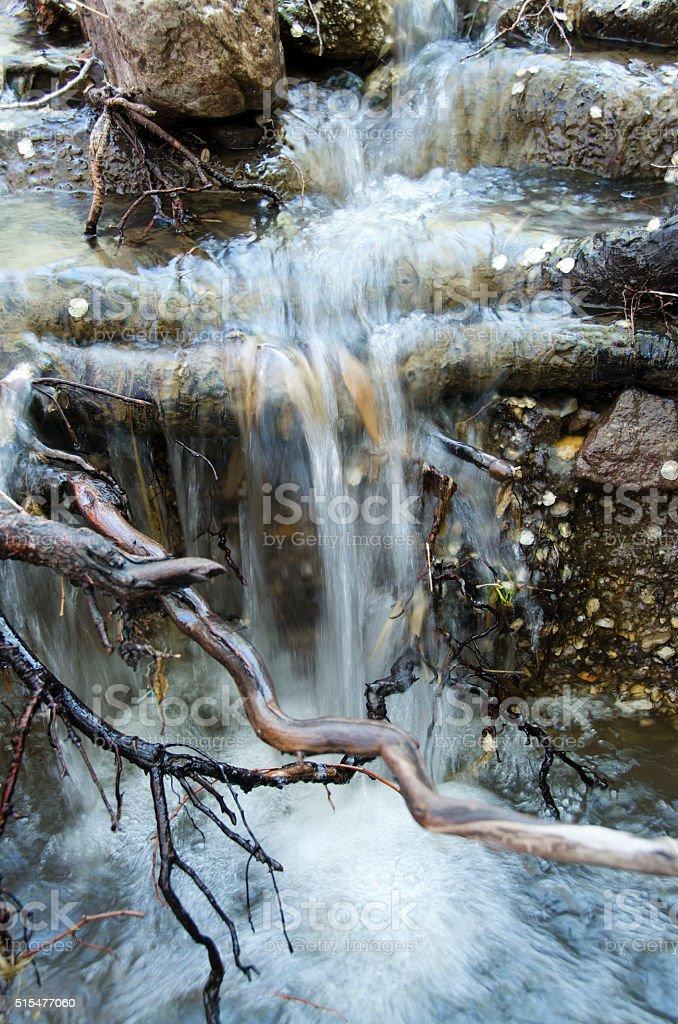 Rushing running creek stock photo