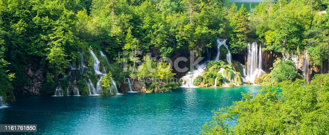 View of waterfalls at the upper section of the lower lake canyon at the Plitvice Lakes National Park. Plitvička Jezera, Croatia - June 25th 2019 - Official photography permission obtained by the Plitvice Lakes National Park and available on request.