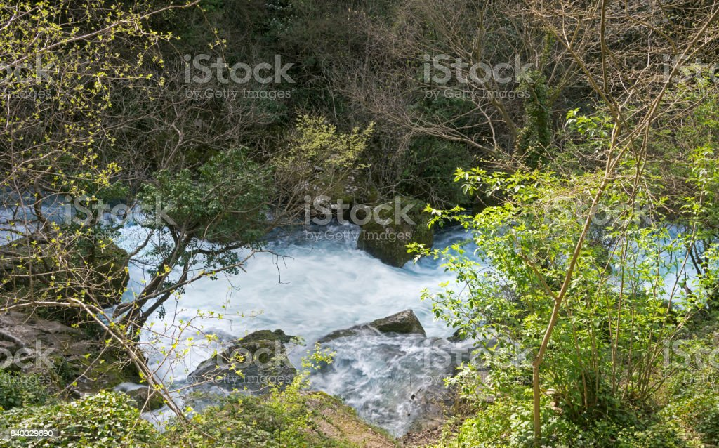 Rushing waters of a subterranean spring, Fontaine de Vaucluse stock photo
