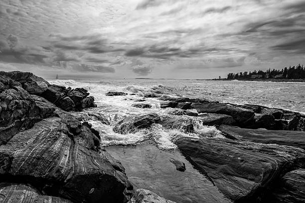 Rushing wave on Maine's rocky coastline stock photo