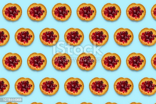 Rusk and raspberry jam pattern on turquoise background
