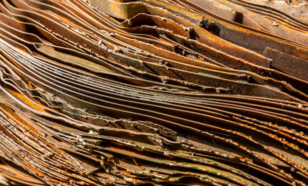 Russet curved metal layers background stock photo