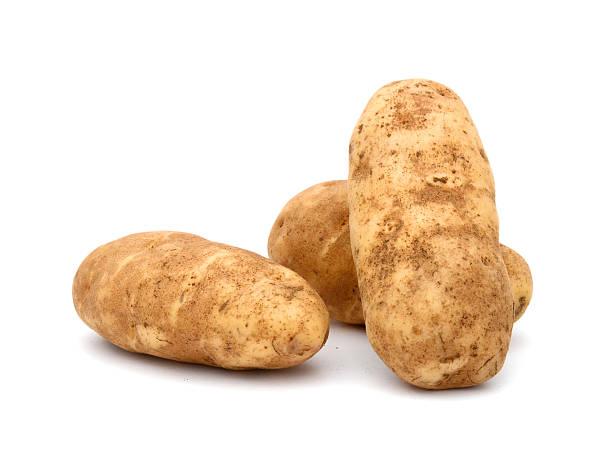 russet potato (idaho potato) in usa - aardappel stockfoto's en -beelden