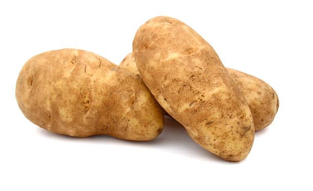 russet potato A russet potato (Idaho potato) raw potato stock pictures, royalty-free photos & images