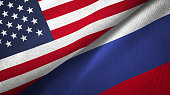 istock Russia and United States two flags together realations textile cloth fabric texture 1089424972