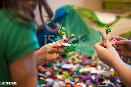 istock 02.01.2018 Russia, Magnitogorsk: children enthusiastically playing Lego. 915992266