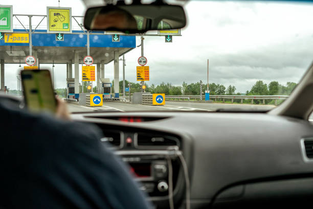 Russia moscow the driver drives up to the toll payment station on a picture id1251749897?b=1&k=6&m=1251749897&s=612x612&w=0&h=a0t1e45t yomq1 2 itj1l5dxf2ijvpimdz4rh9hmfm=