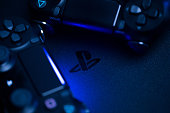 Russia, OKTOBER 24 2019: PS4 console background. Playstation 4 controllers. Sony gaming console