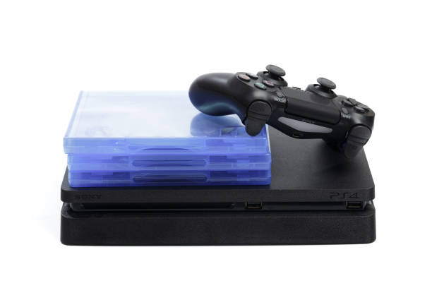 russia, oktober 24 2019:  sony play station 4 pro gaming console on the table with  joystick and some games on dvd for ps4. - ronaldo imagens e fotografias de stock