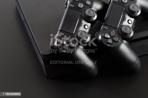 istock Russia, OKTOBER 24 2019: The new Sony Dualshock 4 with PlayStation 4. Sony PlayStation 4 game console of the eighth generation. 1189089883