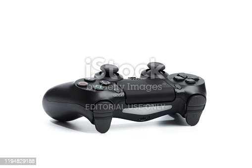 istock Russia, OKTOBER 24 2019: The new Sony Dualshock 4 with PlayStation 4. Sony PlayStation 4 game console of the eighth generation. 1194829188