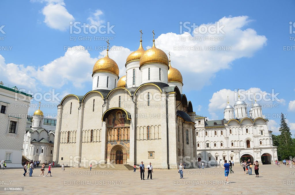 Russia, people walking near Uspensky cathedral in Moscow kremlin stock photo