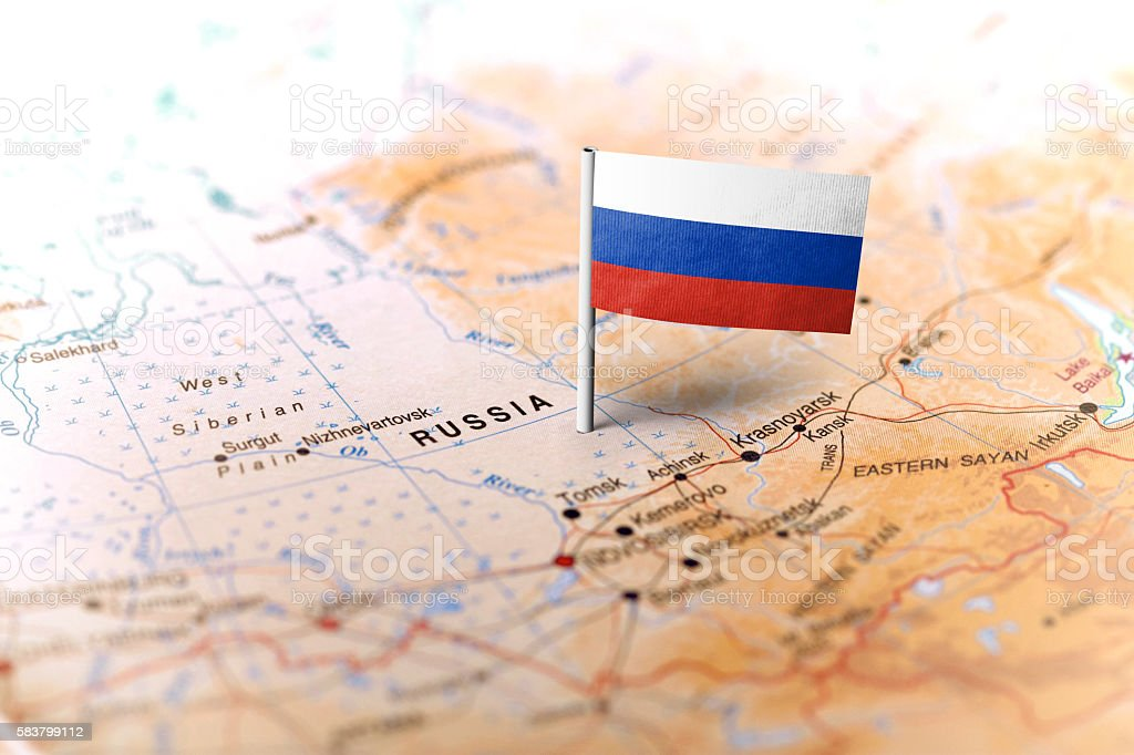 Russia pinned on the map with flag stock photo