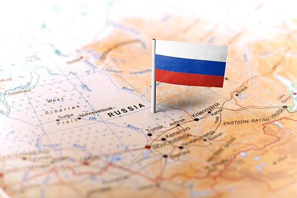russia pinned on the map with flag - russia stock pictures, royalty-free photos & images