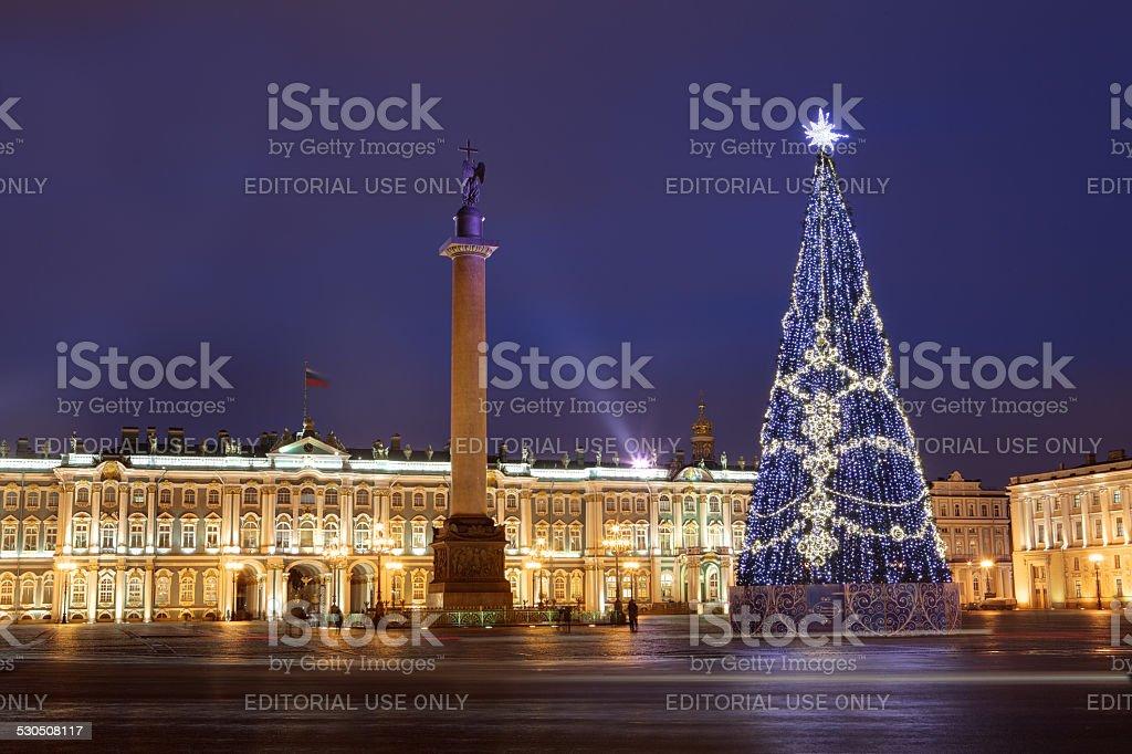 Russia, Saint-Petersburg, Christmas tree lighting at night, near Hermitage Museum. stock photo