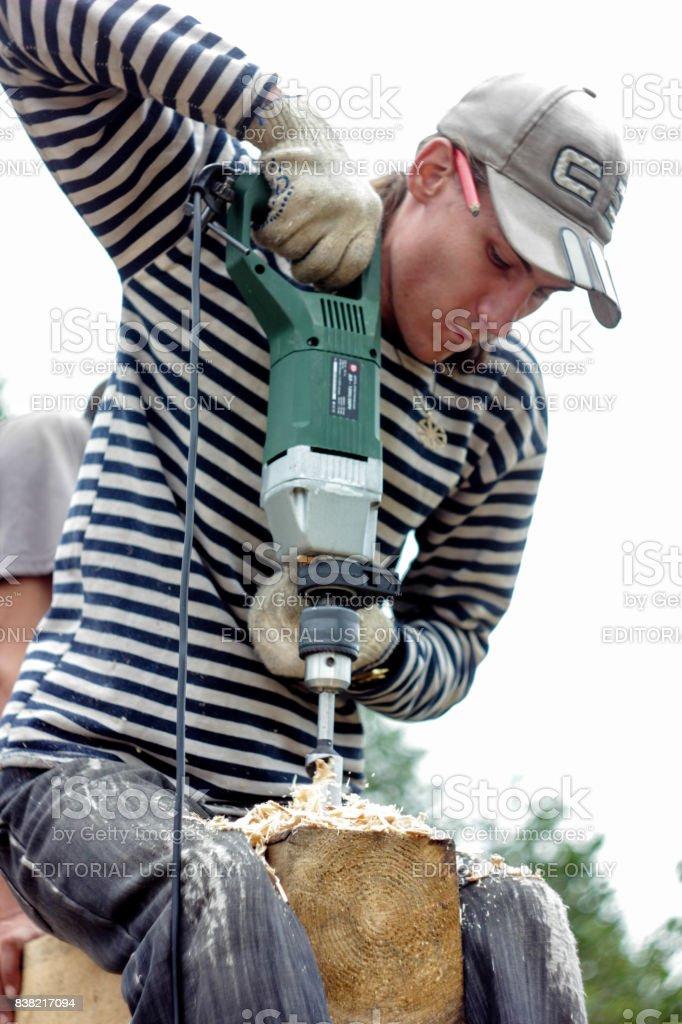 Russia, Siberiya - 1.09.2013: Workers build a house stock photo