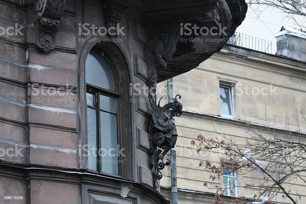 Russia, St. Petersburg. Forged dragon on the house stock photo