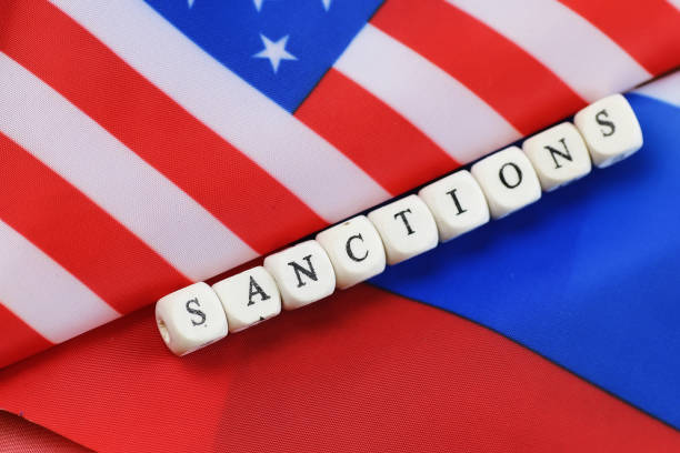 russian and usa flag sanctions russian usa flag sanctions wooden letters on them sanctions stock pictures, royalty-free photos & images