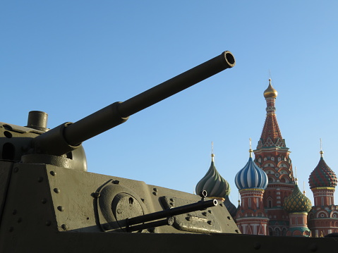 Russian army, tank gun against the St. Basil's Cathedral on Red square in Moscow during military parade