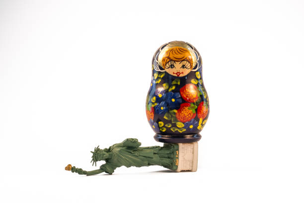 Russian babushka doll standing on top of the fallen Statue of Liberty Russian babushka doll standing on top of the fallen Statue of Liberty michael flynn stock pictures, royalty-free photos & images