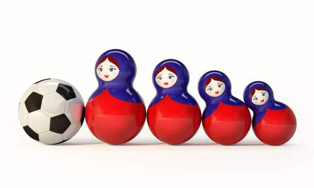 Russian Babushka dolls with football ball. stock photo