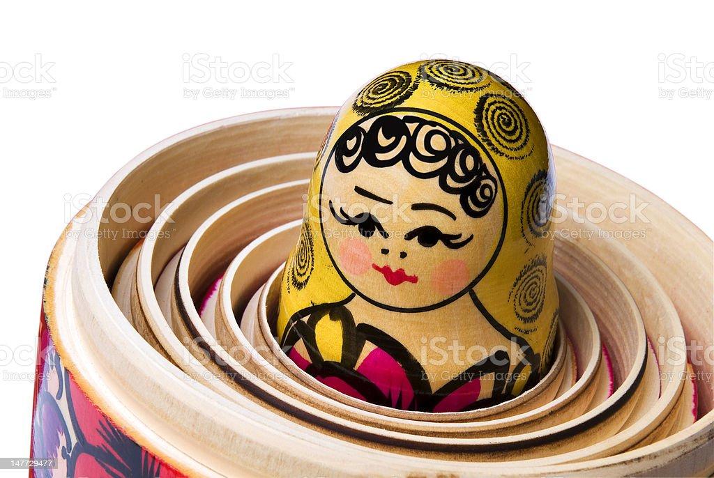 Russian Babushka or Matryoshka Doll inside the other dolls. stock photo