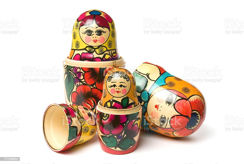 Russian Babushka or Matryoshka Dolls isolated on white background stock photo