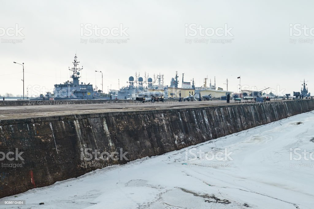 Russian battleships in the dock of Kronstadt. Lighthouse. Saint-Petersburg Russia stock photo