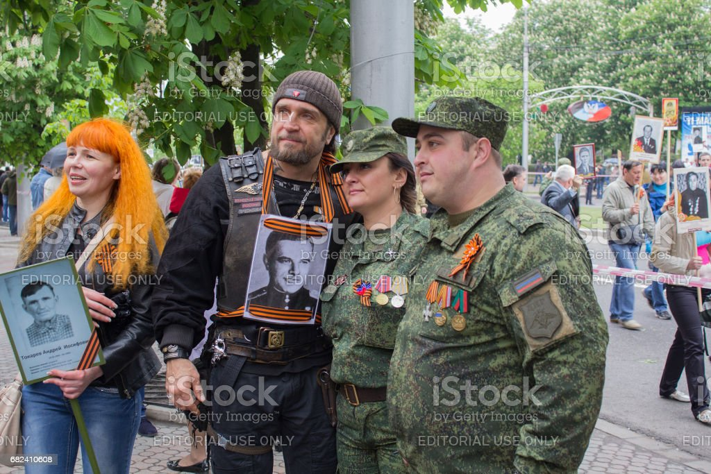 Russian biker Alexander Zaldostanov is photographed with citizens of Donetsk stock photo