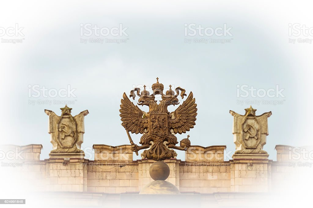 Russian coat of arms on the background of Soviet symbols stock photo